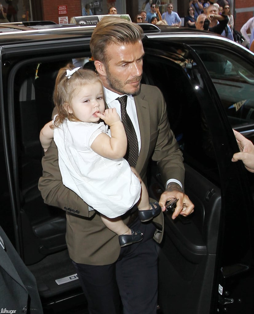The always dapper David Beckham carried Harper to lunch at Balthazar in NYC after attending mom Victoria Beckham's show at NYFW.