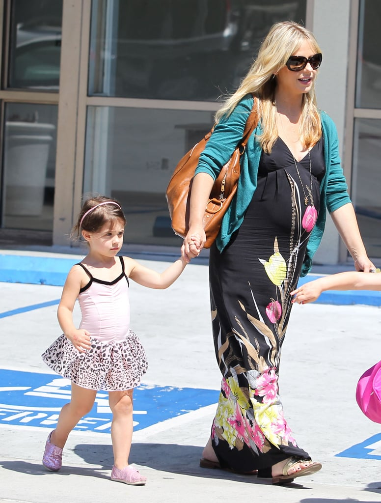 Sarah Michelle Gellar and Charlotte Prinze walked through a parking lot.