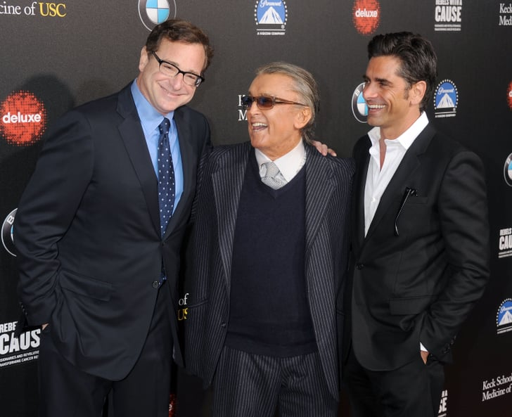 It was another Full House reunion as John Stamos and Bob Saget posed together. They sandwiched film producer Robert Evans in the middle.