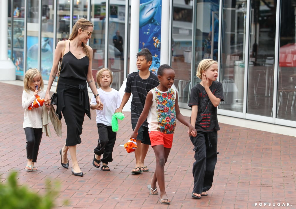 Angelina Jolie and her kida held hands as they walked through Sydney's Darling Harbour.