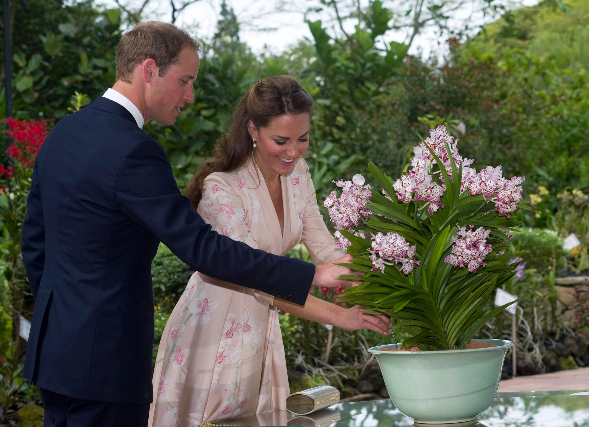 Prince William gave Kate Middleton a helping hand in Singapore in September 2012.