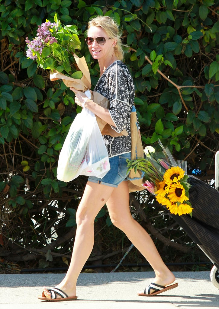 Naomi Watts juggled a lot of flowers in LA on Sunday.