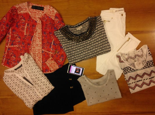 Our loot! We may have got, ahem, a little excited. Clockwise from top left: quilted jacket $119, embellished knit, $69.95, waxed jeans $89.95, Aztec-print tee $35.95, studded tank $35.95, wrap-front short $69.95, printed silk blouse $89.95.
