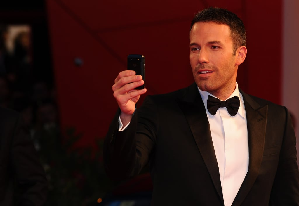 Ben Affleck snapped photos upon his arrival at the September 2010 Venice Film Festival premiere of The Town.