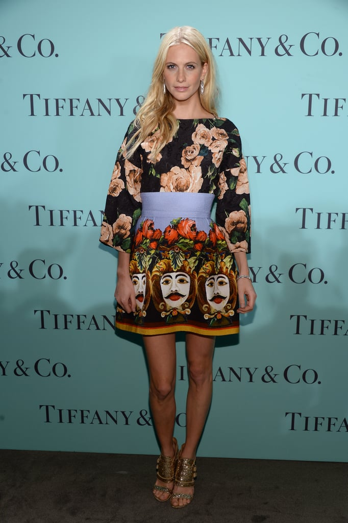 Poppy has a playful side — and a go-to pair of shoes — too. She stepped out for a Tiffany event in a bold Dolce & Gabbana dress and her gold, glittered heels.