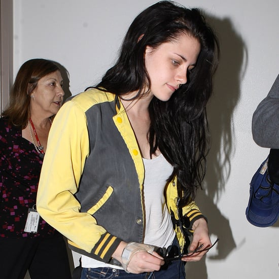 Kristen Stewart Lands at LAX For Breaking Dawn Junket Photos