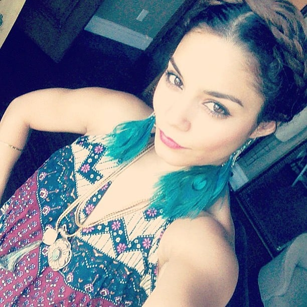 Vanessa Hudgens rocked a cute bohemian look, complete with pretty feather earrings and a braided updo. Source: Instagram user vanessahudgens