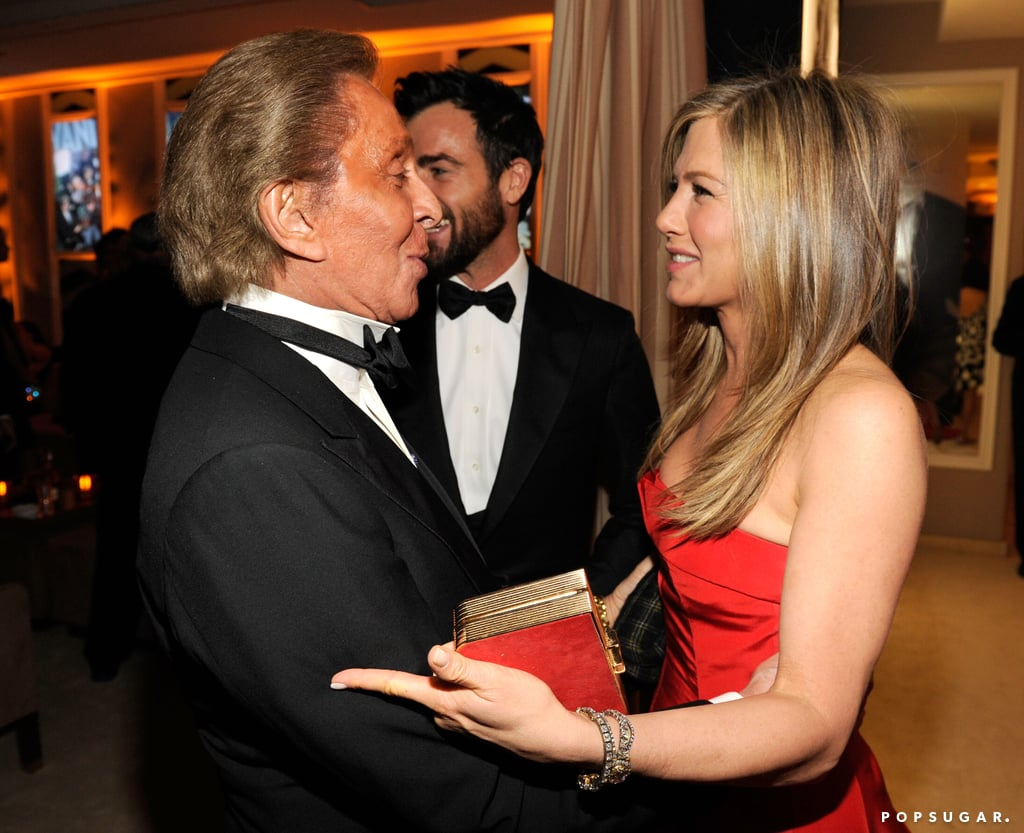 Jennifer Aniston shared a moment with Valentino Garavani at the Vanity Fair Oscar party after Sunday night's award show.