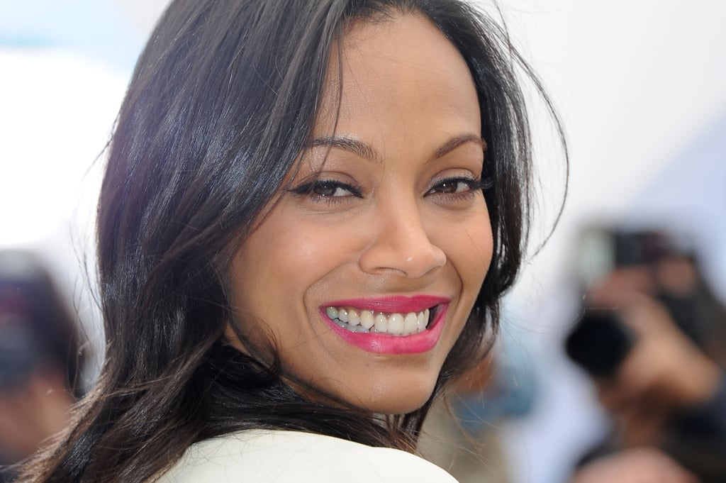 Zoe Saldana looked fresh and bright with a pop of pink on her lips at the Blood Ties photo call.
