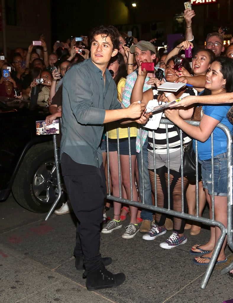 Orlando Bloom signed autographs for fans outside his Broadway play.