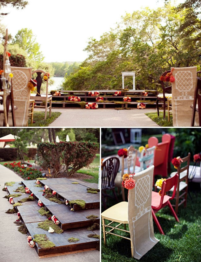 For an Anthropologie-esque setup, try stacking pallets on top of each other to create a mini wooden stage. Then slip in some flower arrangements to brighten the look. Photo by EE Photography via Green Wedding Shoes