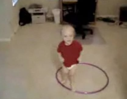 Baby Tries to Hula Hoop