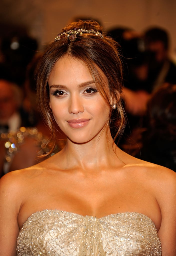 A whimsical updo with a glittering hair accessory accented Jessica's ensemble at the 2001 Met Gala.