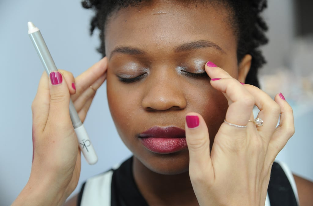 Feel free to skip eye shadow and mascara altogether. McAdams recommends pairing a bold lip with an equally bold brow and minimal face.  Another alternative is to add a metallic highlight for shadow like Gloss Eye Color in Ultra ($17), focusing on the inner corners and the center of the eye. Then, blend.