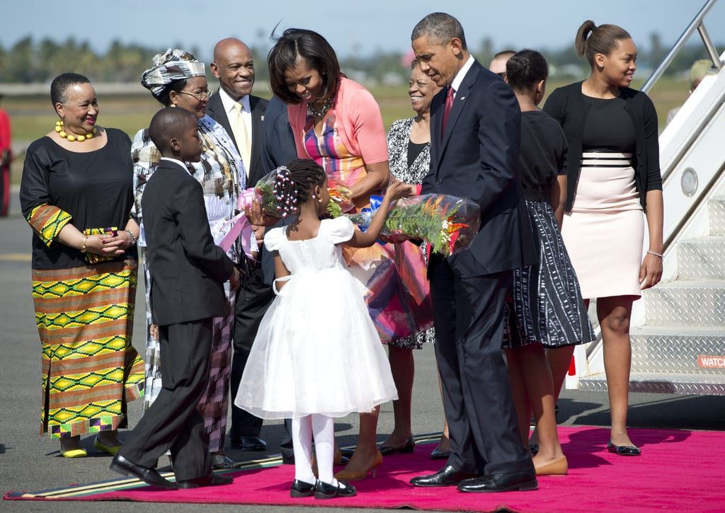 Children greeted President Obama and First Lady Michelle with flowers when they arrived in Dar Es Salaam, Tanzania, in July 2013.
