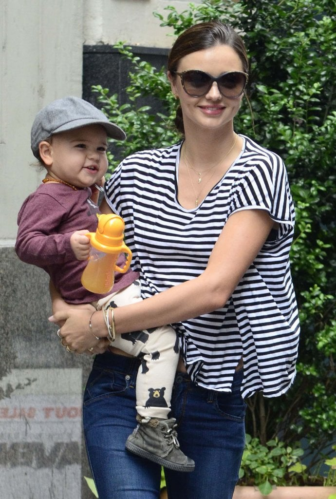 In July, Miranda Kerr's baby, Flynn Bloom, wore bear-printed pants and a newsboy cap in NYC.