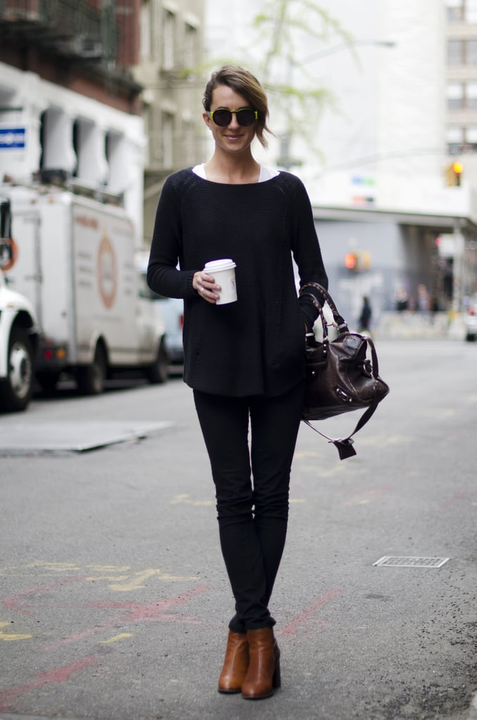 Rework a classic crewneck with standout sunglasses and buttery ankle boots.