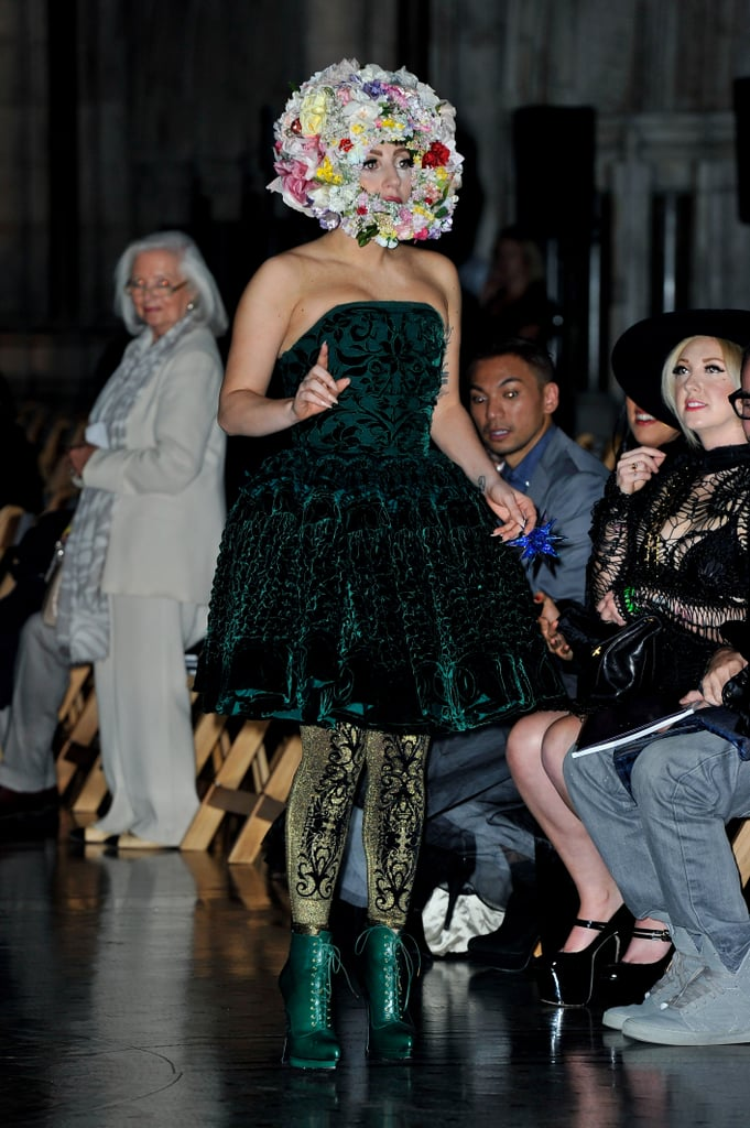 Lady Gaga topped her velvet strapless dress and baroque leggings with a blossoming floral helmet at Phillip Treacy.