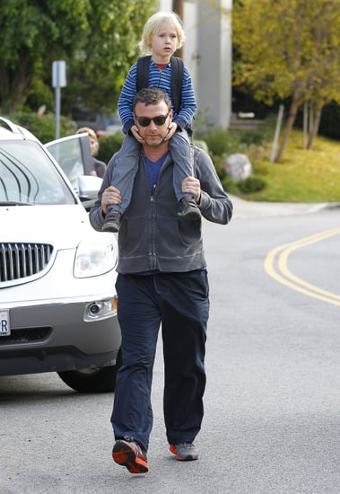 Liev Schreiber and Sasha walked on the street.