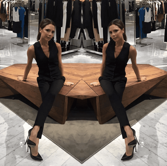 Victoria Beckham Wearing Black Vest and Pants 2016