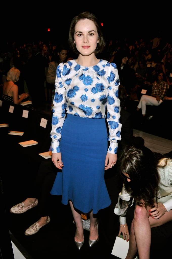 Michelle Dockery was feeling blue in a printed blouse and flared skirt while front row at Carolina Herrera.