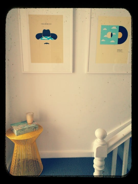 A cute little nook at the top of our staircase. These two prints were a wedding gift, and the stool gives a nice splash of colour against the white walls and grey carpet. For a little retro flair I used the Phototastic app for this pic.