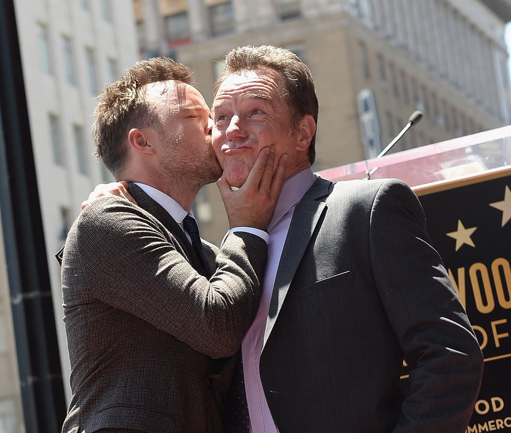 Bryan Cranston got a big kiss on the cheek from Breaking Bad costar Aaron Paul.