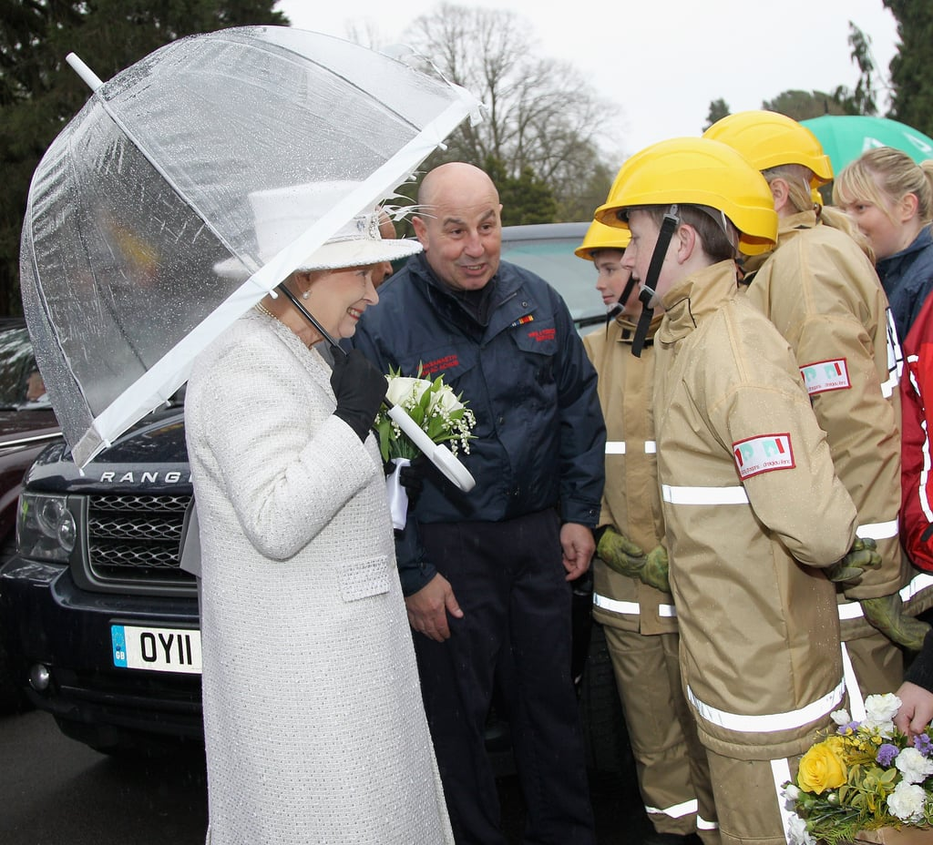 Queen Elizabeth II held an umbrella during a rain shower as she visited Cyfarthfa High School and Castle on April 26 in Merthyr, Wales.