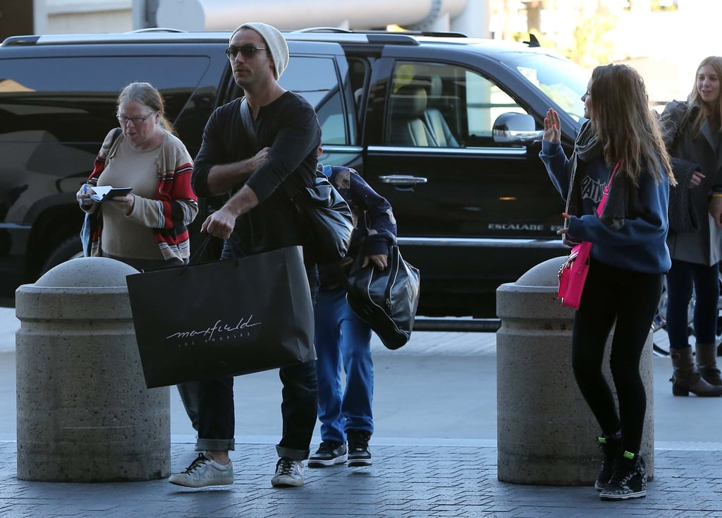 Jude Law arrived at LAX with his children.