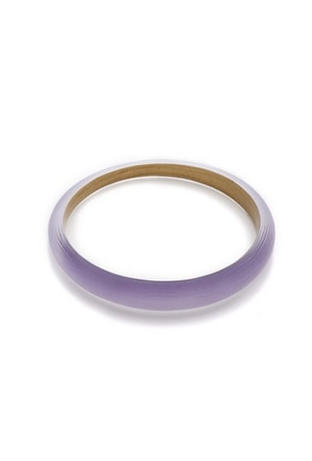 Slip on Alexis Bittar's Skinny Tapered Bangle ($65) with the rest of your arm party for a jolt of springtime.