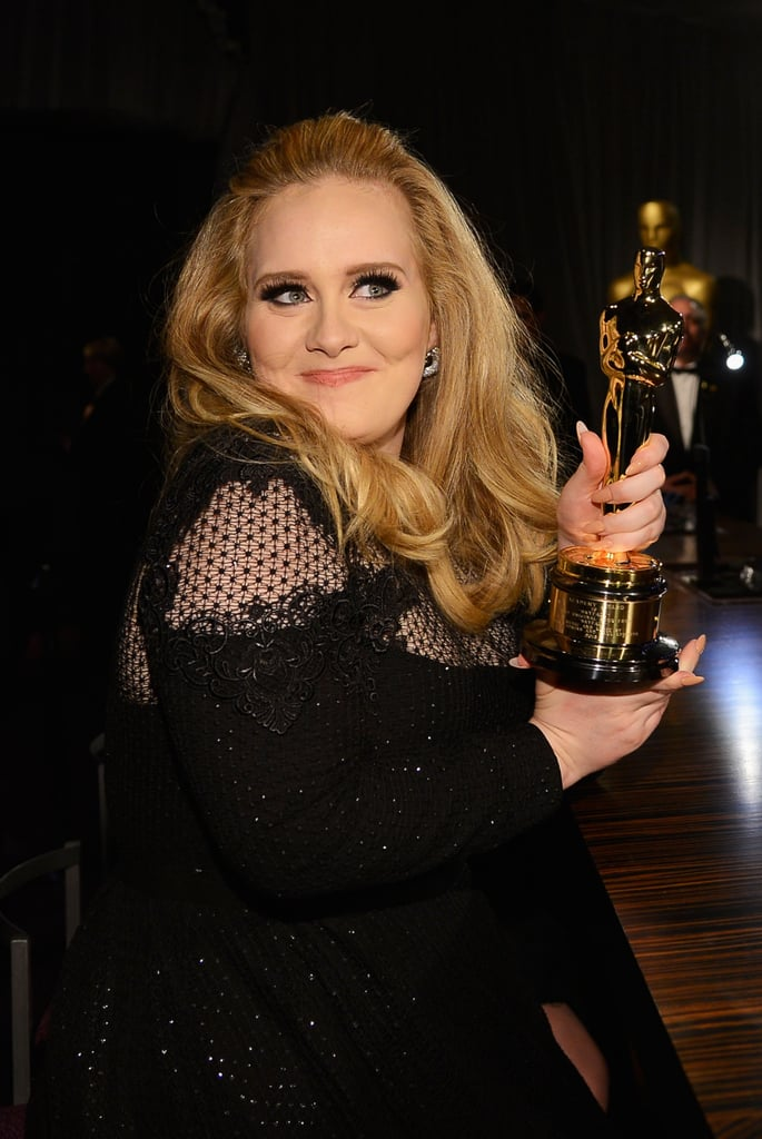 Adele clung to her award at the Governors Ball.