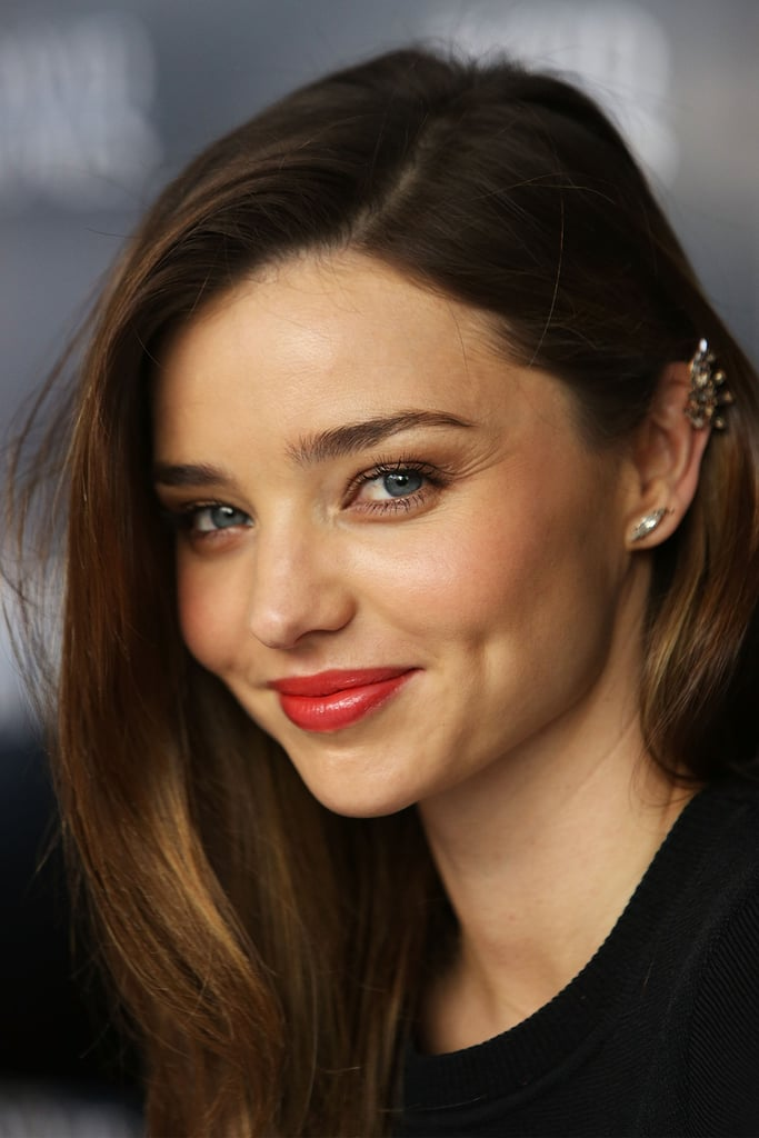Miranda Kerr wore her hair down and finished off her look with red lipstick.