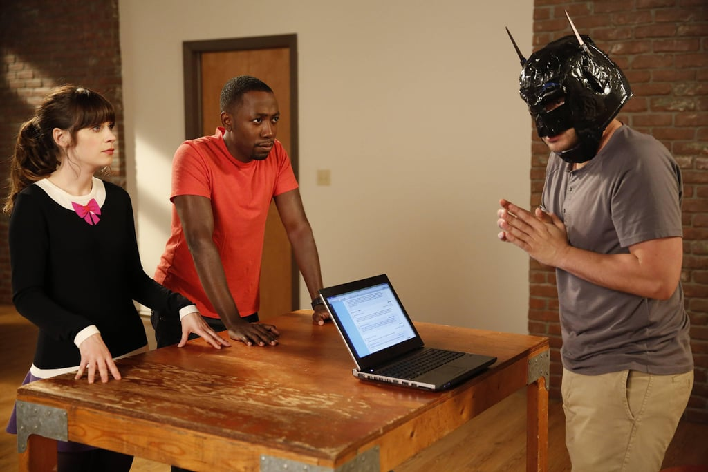 New Girl Nick (Jake Johnson) gets into the spirit with a Batman mask.