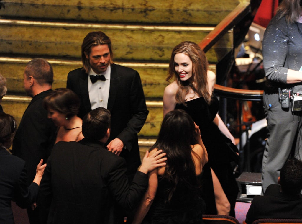 Angie flashes a huge smile to Brad's Moneyball co-star Jonah Hill.