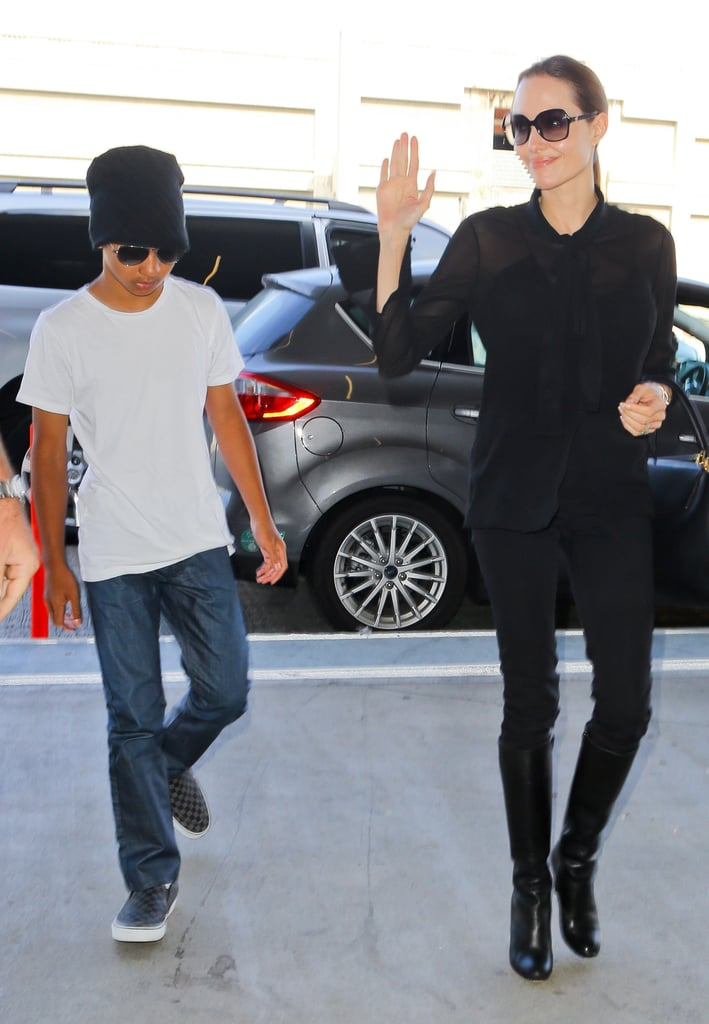 Angelina Jolie waved to fans while walking with Maddox.