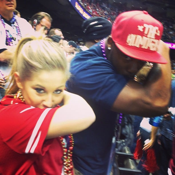 Shawn Johnson kissed her bicep while at the Super Bowl. Source: Instagram user shawnjohnson