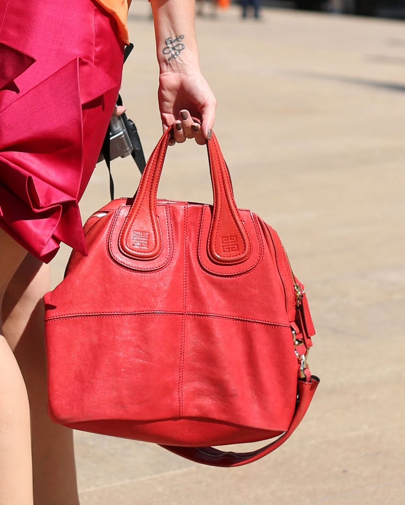 A statement red Givenchy made this outfit pop. Source: Greg Kessler