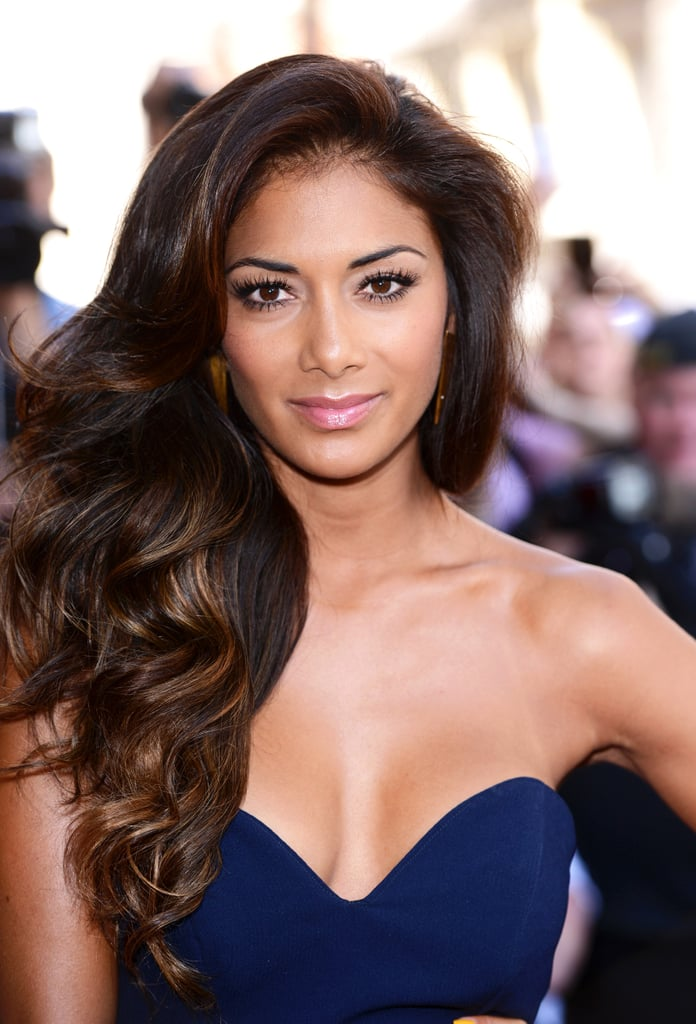 At a press event for The X Factor, Nicole Scherzinger kept her makeup simple with flirty lashes and glossy pink lips. Her long, cascading waves were the focal point of her look.