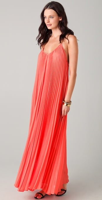 A gorgeous hue and feminine pleats feel pretty, but not overdone — perfect for an outdoor or beachy wedding with a slim belt to cinch the waist.  Bcbgmaxazria Edita Pleated Maxi Dress ($348)