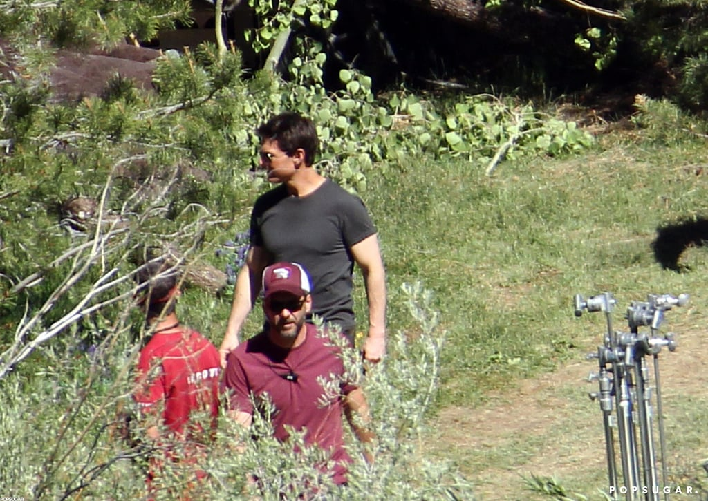 Tom Cruise smiled as he chatted with crew members on the Oblivion set in CA.