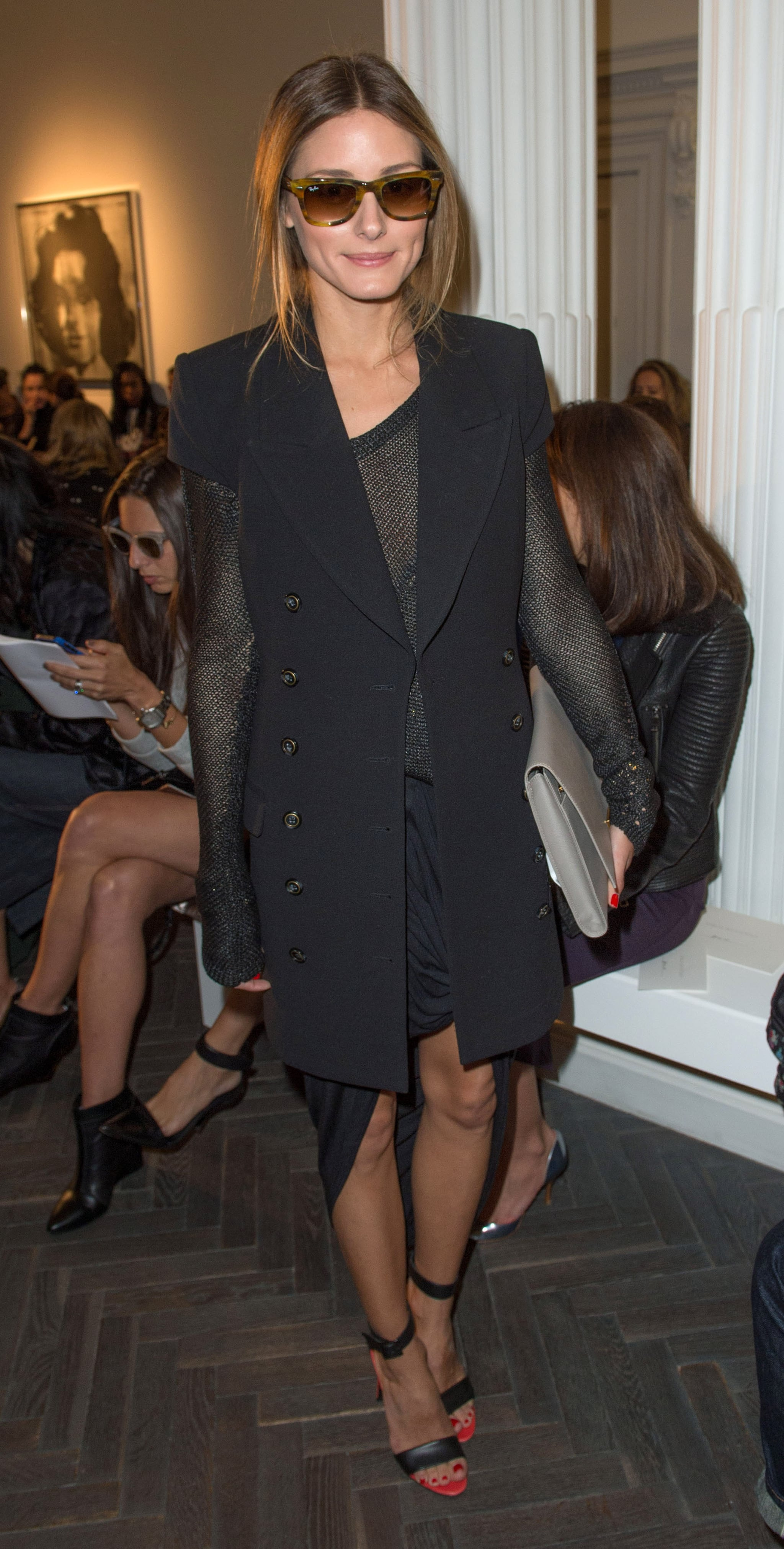 She complemented her military-inspired short-sleeved coat again in London at Emilia Wickstead with an edgy, slinky top and skirt.