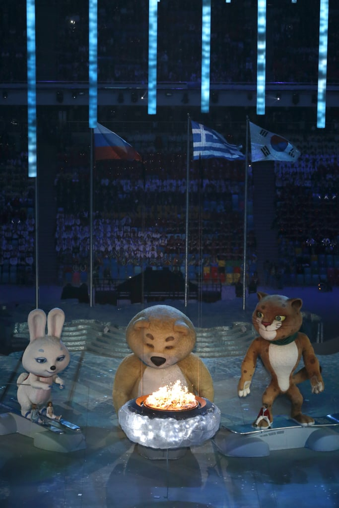 The Sochi bear stood beside the Olympic cauldron.