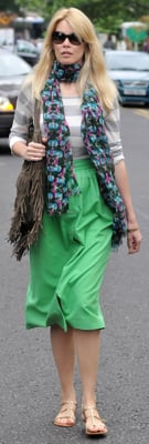 Claudia Schiffer Wears Green Skirt and Striped Top