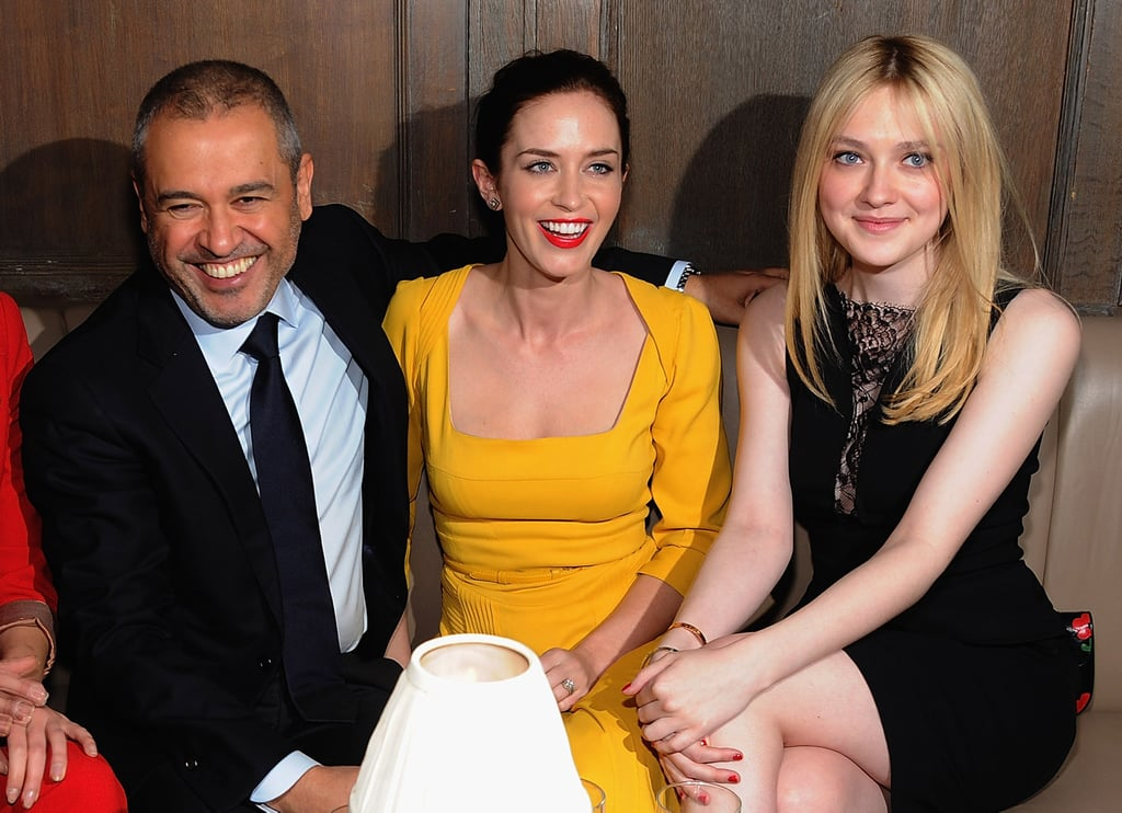 Elie Saab, Emily Blunt, and Dakota Fanning found something very funny at a private dinner for Elie Saab in NYC.