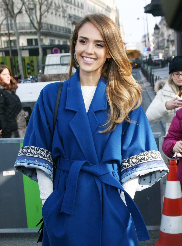 Jessica Alba was all smiles in a bright blue coat arriving at Kenzo.