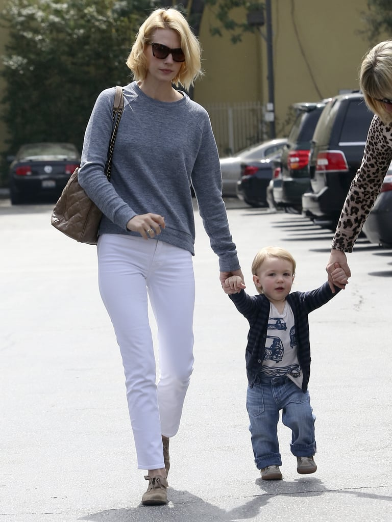 January Jones wore a gray sweater and white jeans for her family lunch in LA.