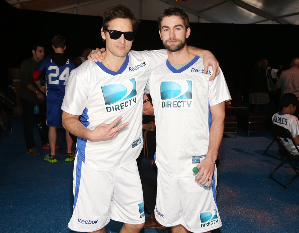 Teammates Peter Facinelli and Chace Crawford buddied up during the 7th Annual Celebrity Beach Bowl game Saturday.