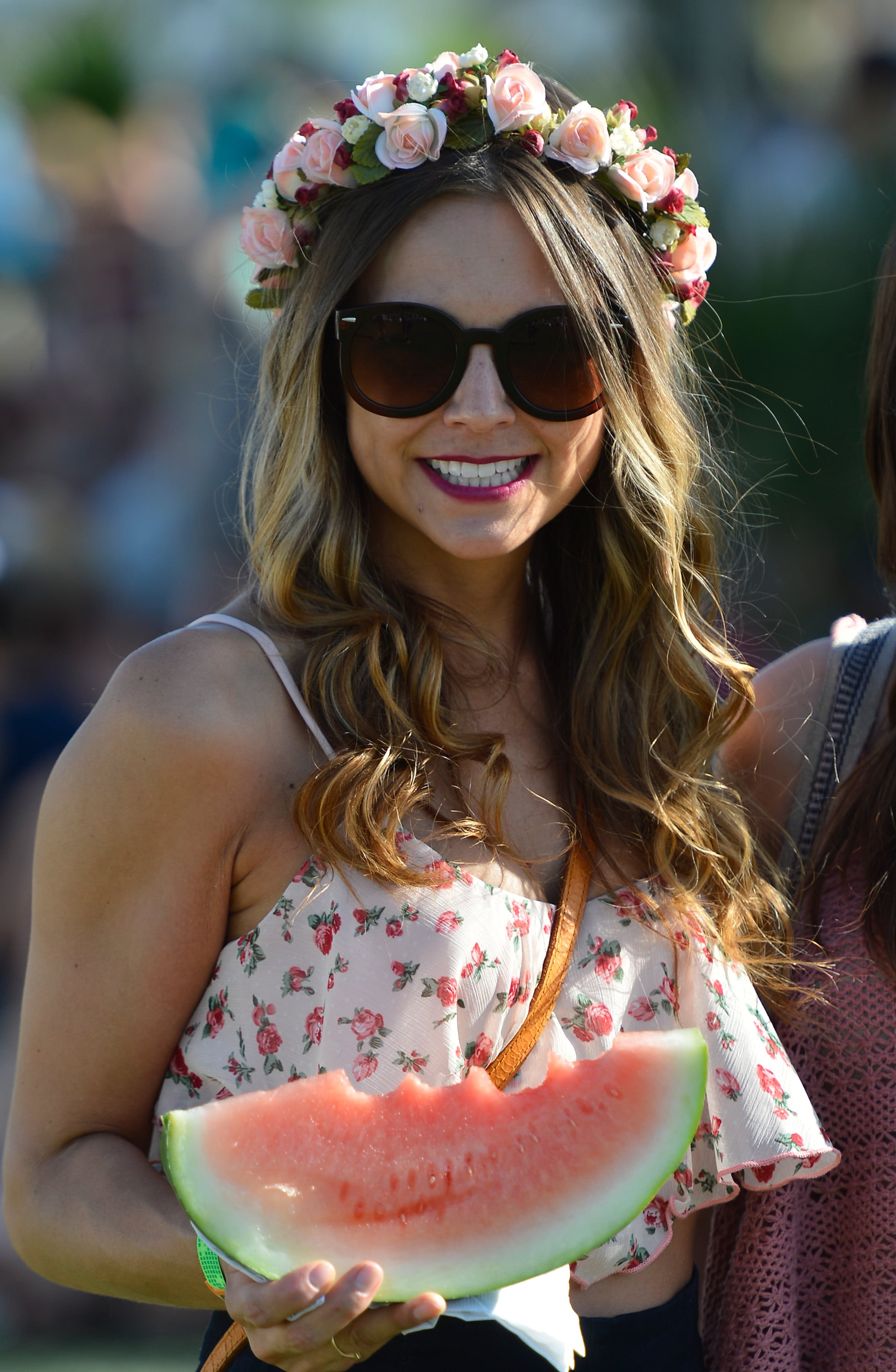 A berry lipstick and coiled curls paired beautifully with a rose headband . . . and a slice of watermelon.