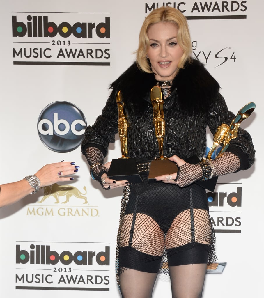 Madonna held onto her awards in the press room.