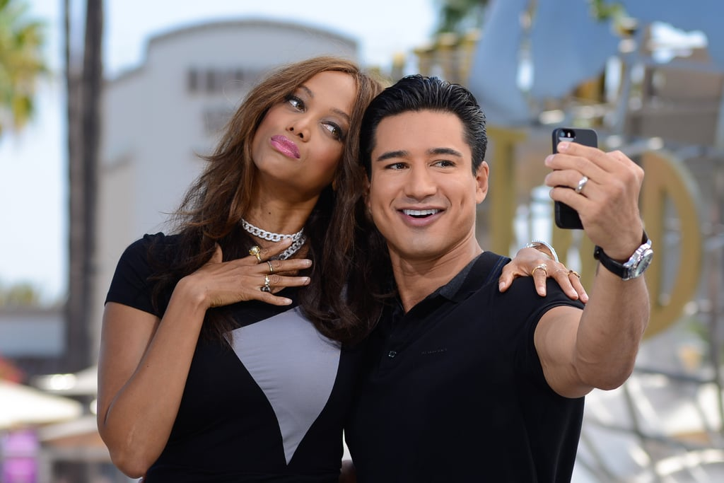 Tyra Banks and Mario Lopez took a photogenic selfie while filming Extra in LA on Wednesday.